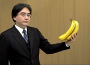 Iwata holding a bunch of bananas